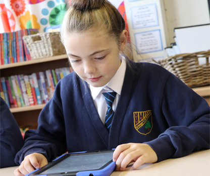 A pupil working on an iPad