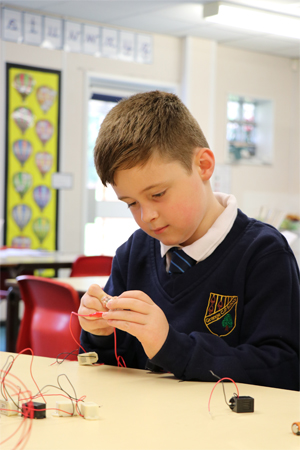 A pupil working with a maths block