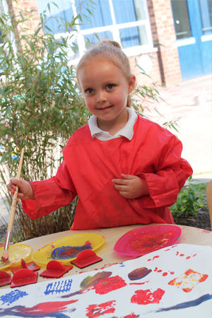 A pupil painting outside