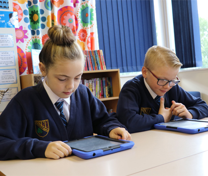 2 pupils working on iPads